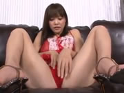 Momoka Rin shows off in red lingerie masturbating